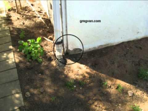 Plugged Underground Drain And Gutter Creates Stucco Damage - Property Damage