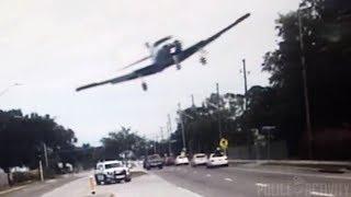 Police Dashcam Captures Small Plane Crashing Onto Florida Road