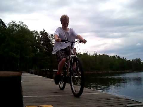 Kid falls down in water with bike
