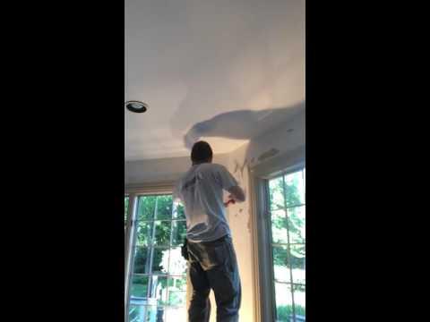 Skimming drywall walls after wallpaper removal.