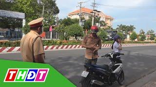 Xử phạt người điều khiển xe máy không gắn kính chiếu hậu | Câu chuyện giao thông | THDT
