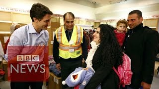 Canada: PM Justin Trudeau welcomes Syrian refugees - BBC News