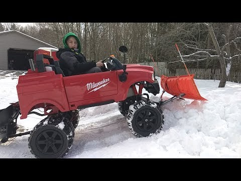 Extreme Powerwheels 4x4 truck with V-plow and salter