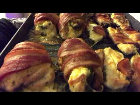 Bacon wrapped chicken thighs stuffed with cream cheese filled jalapeños