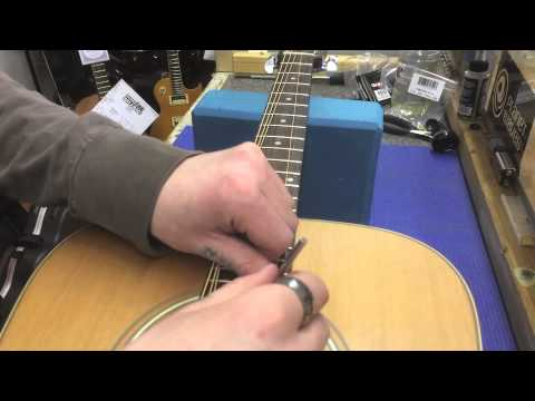 How to adjust the truss rod/string buzz on an acoustic guitar by KSM Music