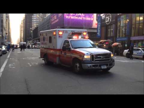 NYU MEDICAL CENTER & FDNY EMS AMBULANCES LEAVING WITH PATIENT WHO WAS RESCUED FROM UNDER TRAIN.