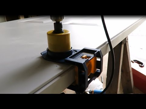 How to drill the knob and bolt holes in a door with an Irwin kit.