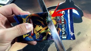 CUTTING BOOSTER PACKS IN HALF WITH AN ELECTRIC KNIFE!