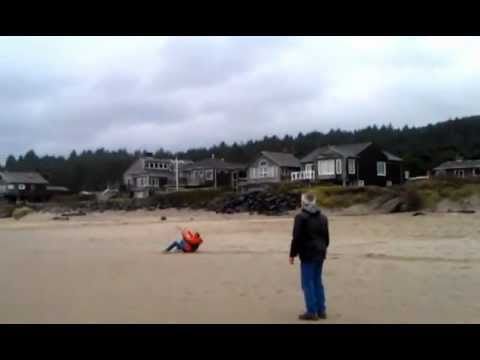 Flying a trainer kite in gusty conditions at Cannon Beach