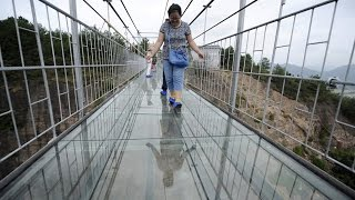 Glass Bridge Cracks Under Tourists' Feet