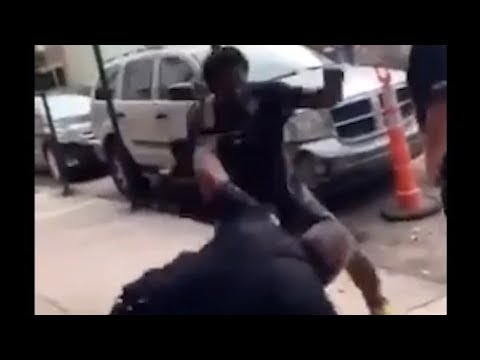 Man punches cop several times as cop's partner watches