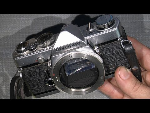 How to take off the top cover on Olympus OM-1 and other details