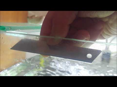 How to clean limescale with blade on aquarium glass