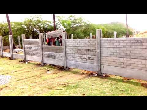 Brick pattern garden fence using concrete gravel boards