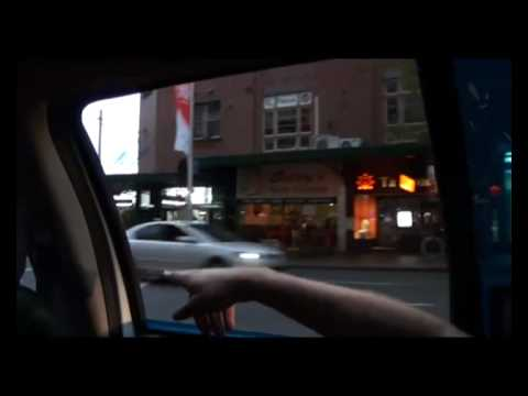 L plater driving new Volkswagen Beetle convertible on Oxford St
