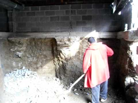 MAN Digs nine foot Basement Under An Existing House By George Darmis....