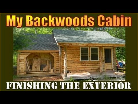 Siding my Backwoods Cabin with logs I milled on my property.