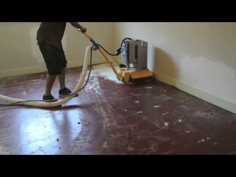 Removing paint from concrete with grinder