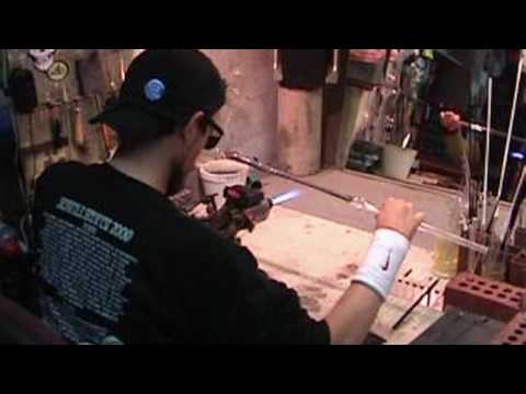 Glass Blowing - Stretching, twisting and pulling tubing - Close up - Glass4Life