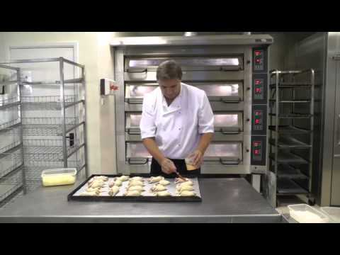 Bread and pastry baking on a professional deck and rack oven.