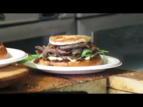French Food in the Streets of London. The Cooking of the Duck Meat Confit Burger