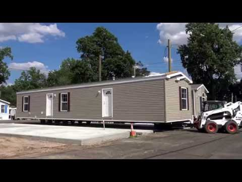 And this is how it's done! Final placement of a manufactured home (mobile home) in Edison