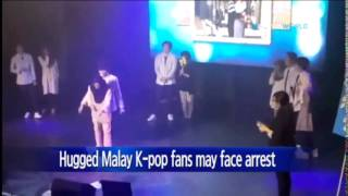 Malay girl fans could face arrest for hugging K-pop boy band / YTN