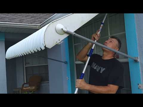 Irma prep: Cleaning and closing awnings.