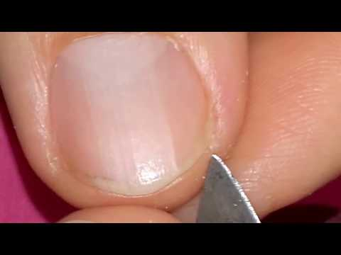 Cleaning my fingernails.