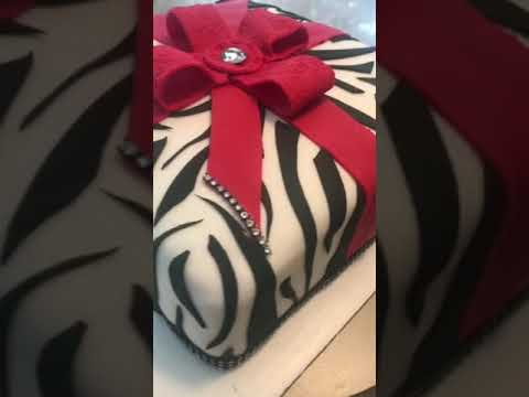 Zebra Print Cake with Red Bow