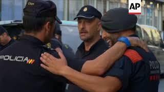 Spanish, Catalan police embrace in Barcelona