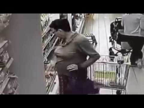 Crazy woman takes a pee in the store