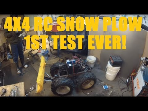 Homemade RC 4x4 Snow Plow first test in light snow