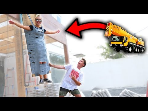 DUCT TAPING MY SISTER TO A CRANE!