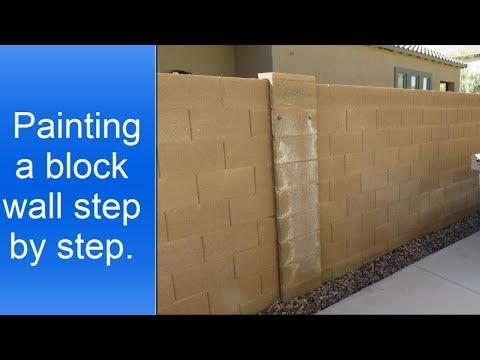 Painting exterior cinder block wall.
