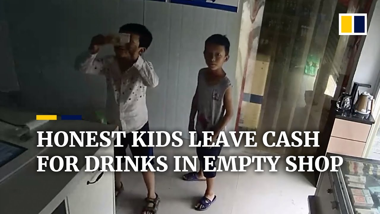 Trustworthy kids show banknotes to security camera while shopkeeper is away