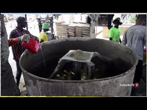 Made in Ghana cement mixer, block molder and wheel barrow
