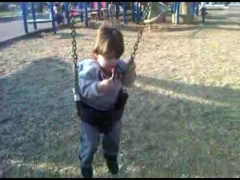 Luka on a swing with a lollipop 20100313-1612.3GP