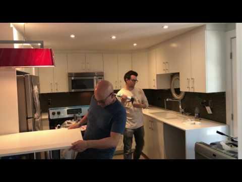 Quartz countertop and backsplash installation