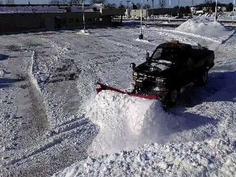 NEW 9.5' FLAIRED WING V SNOW PLOW AT WORK ON DIESEL 1 TON TRUCK