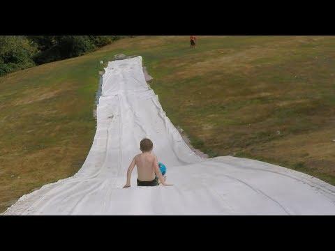 Huge Slip n Slide down the side of a hill! #fail