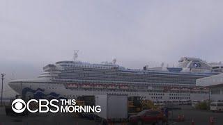 Coronavirus-quarantined cruise passengers battle illness, boredom