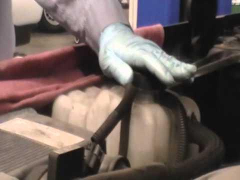 How to check coolant level of a 2006 Chevy Silverado