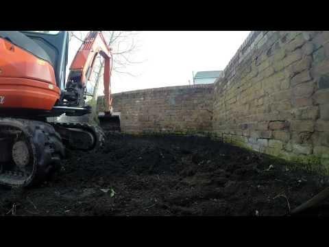 Kubota U25-3 Mini Digger Leveling A Garden