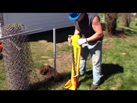 Pop old fence posts right out with manual post puller