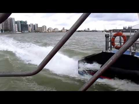 Fast ride on a london river boat service at Canary Wharf