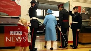 Child hit in face by soldier saluting the Queen - BBC News