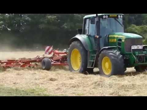 John Deere 6830 tractor with massive hay tedder