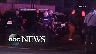 Officers injured in shooting after confronting suspect