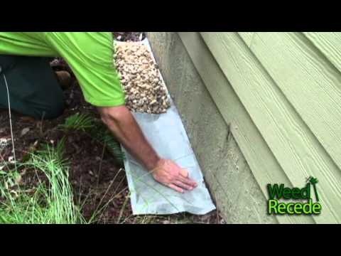 Easy to Install Rock EcoBoundary(c) around House using Weed Recede TM